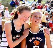 Liza Hitchner gives Aly Millett a warm welcome after Millett won the distance medley relay for Half Moon Bay Saturday.